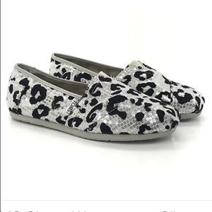 Toms limited edition slip ons